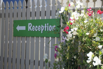 YHA Oamaru : Exterior Sign to Reception in Oamaru Hostel, New Zealand