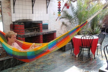 Arica - Doña Inés : Guest zooming options on hammock on Patio in Arica - Dona Ines, Chile