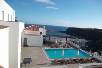 Azores - S.Maria Is. - Vila do Porto : Exterior view and pool area of the Vila do Porto hostel in Portugal