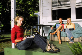 YHA Opoutere : Guests Relaxing on the Patio at Opoutere Hostel, New Zealand