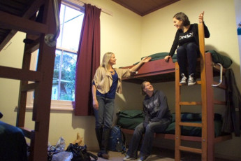 YHA Opoutere : Guests Relaxing in the Dorm Room at Opoutere Hostel, New Zealand