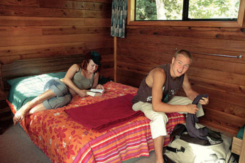 YHA Opoutere : Guests Relaxing in the Double Bedroom at Opoutere Hostel, New Zealand