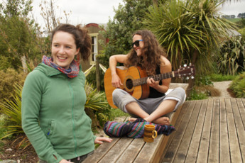 YHA Raglan : Guests Relaxing on the Patio at Raglan YHA - Solscape Eco Retreat Hostel, New Zealand