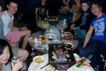 Yakushima - Yakushima YH : Guests Dining in Yakushima - Miyanoura Port Side Youth Hostel, Japan