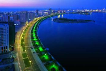 Sharjah Hostel : City Surrounding Sharjah Hostel, United Arab Emirates in the Evening