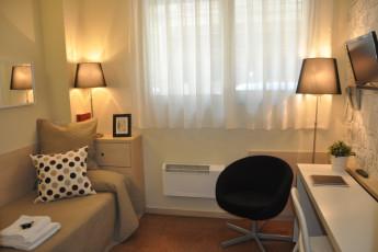 Bilbao - Blas de Otero : Desk and Sofa in Room at Bilbao - Blas de Otero Hostel, Spain