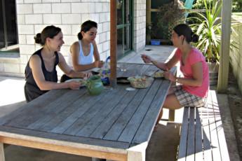 YHA Anakiwa : People in courtyard of the Anakiwa Lodge Hostel in New Zealand