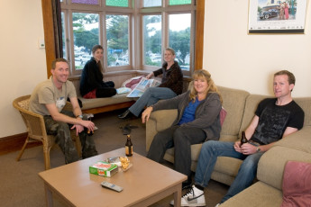 YHA Napier : People in lounge of Napier YHA hostel in New Zealand
