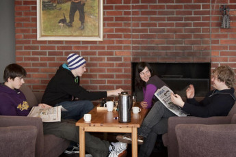 Førde : Four people by the fireplace