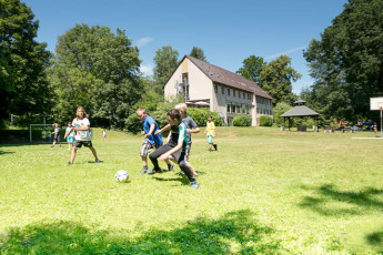Hann.Münden : Children playing football outside Hannoversch Münden Hostel, Germany