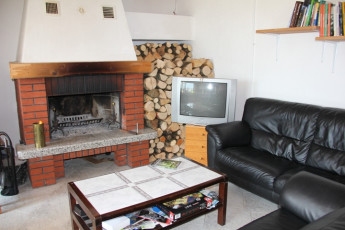 Youth Hostel Bovec : 092580 - Bocev Hostel, fireplace image