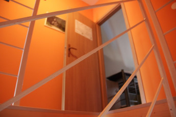 Youth Hostel Bovec : 092580 - Bocev Hostel, orange stairs image
