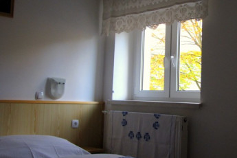Youth Hostel Barovc : X403446, Hostel Barovc, double bed with window image
