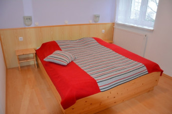 Youth Hostel Barovc : X403446, Hostel Barovc, double bed with orange cover image