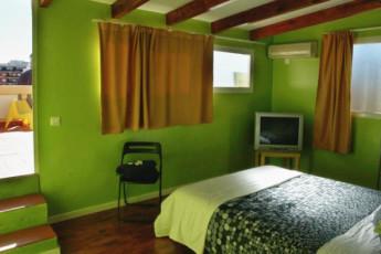 Valencia – Purple Nest Hostel : purple nest bedroom and terrace
