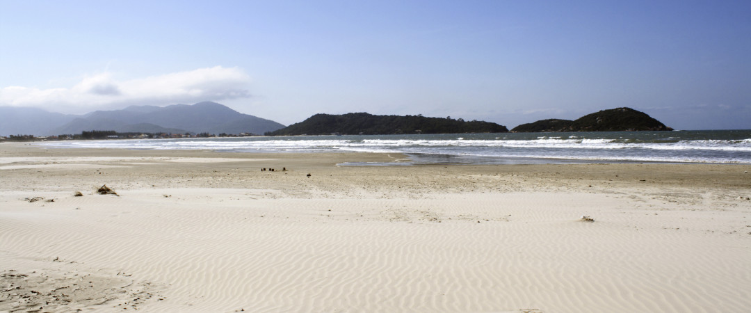 Hit the beautiful beach of Florianópolis - the white sand and blue sea makes for a wonderful setting. Sit, swim or surf.
