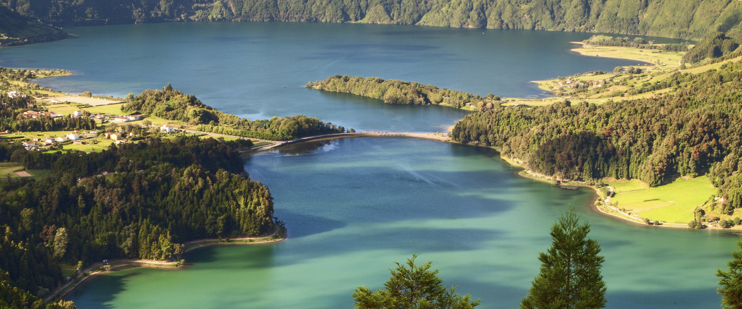 See the stunning volcanic crater lakes on the island of São Miguel where an abundance of outdoor sports await you.