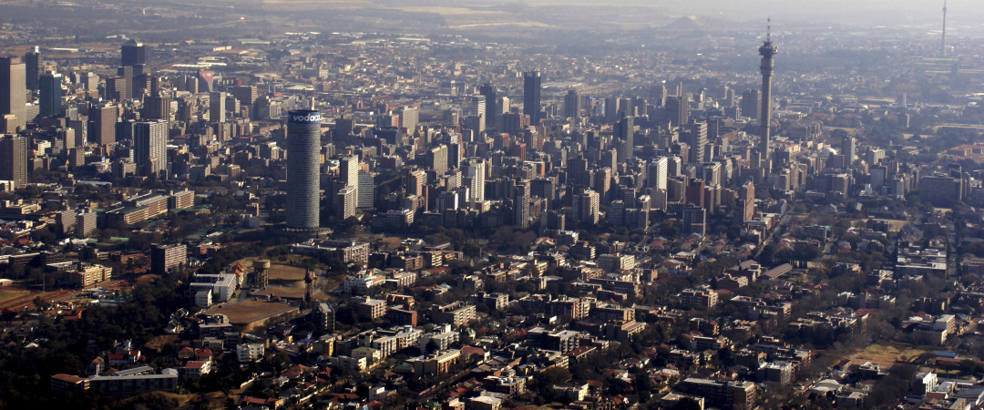 Can you spot the landmark towers in this panoramic shot showing the bustling centre of Johannesburg?