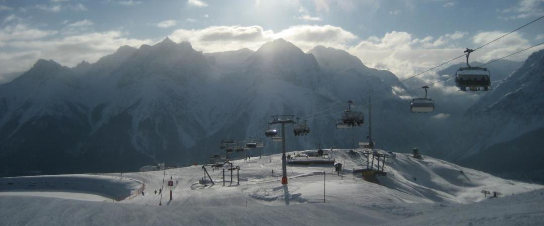Take a trip on a cable car and enjoy the beautiful views of the snow covered mountains in Scuol.