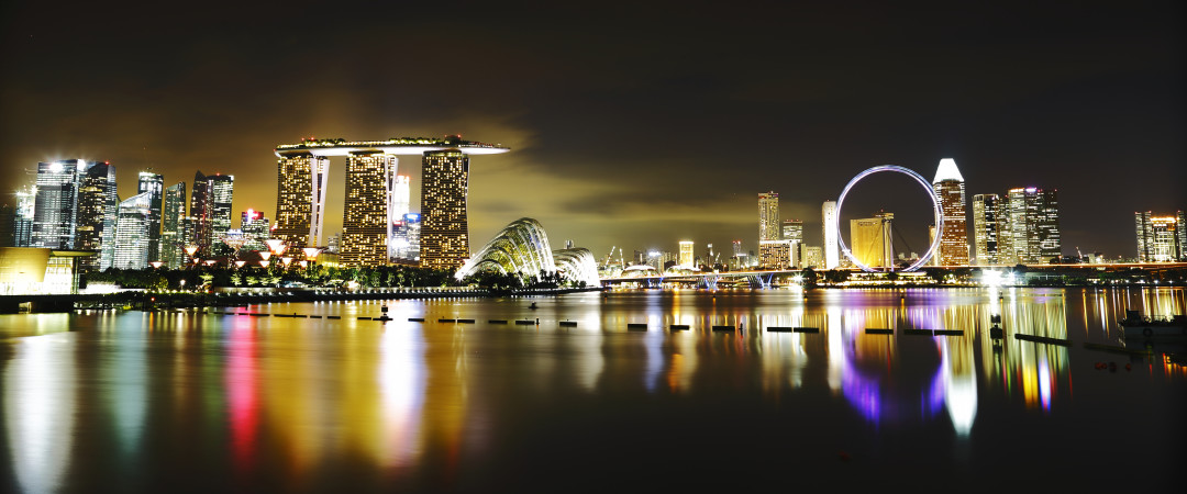 Singapore at night - go upmarket at top clubs and bars or keep it casual by eating at colourful street stalls.