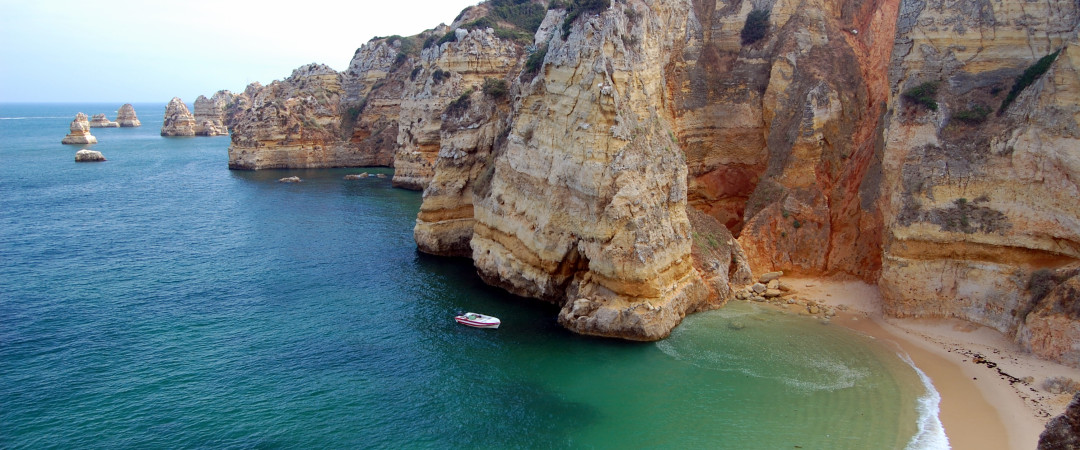 Spend a relaxing day on Praia Dona Ana beach and feast your eyes on the striking cliffs.