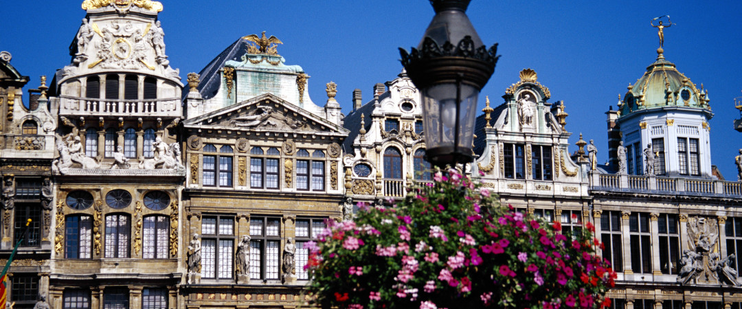 Walk alongside the canal and admire the flamboyant architecture of Ghent - a small city with a big personality.