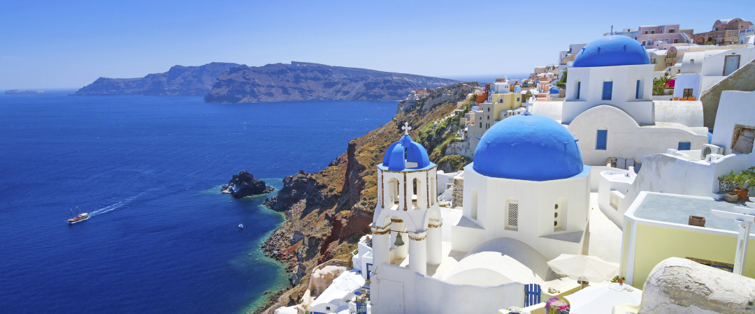 Visit the unforgettable island of Santorini; catch the rays on Kamari beach, shop in Fira and see spectacular sunsets over the roofs of Oia.
