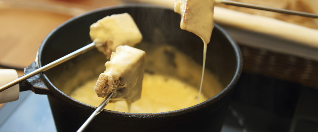 Try some fondue, one of Switzerland's most popular dishes. It consists of melted cheese - perfect for dipping!