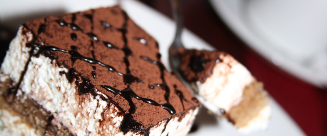Indulge in a serving of tiramisu - this decadent, espresso-enriched desert translates as 'pick me up'.