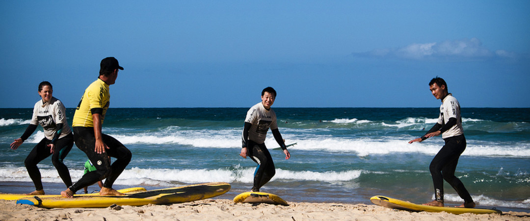 Brave those waves and work on your surfing skills at Manly surf school!
