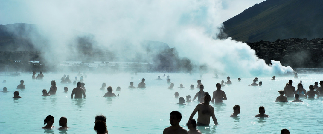 Relax in the stunningly beautiful blue lagoon, one of the most unique attractions in Iceland.