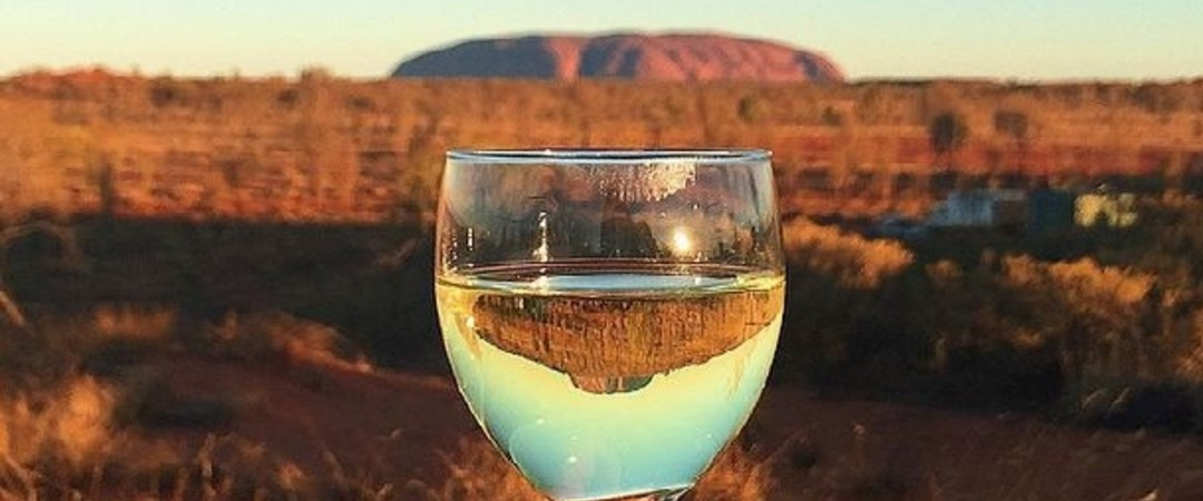 Watch movies under the stars and explore Australia's red centre with a glass of local chardonnay.