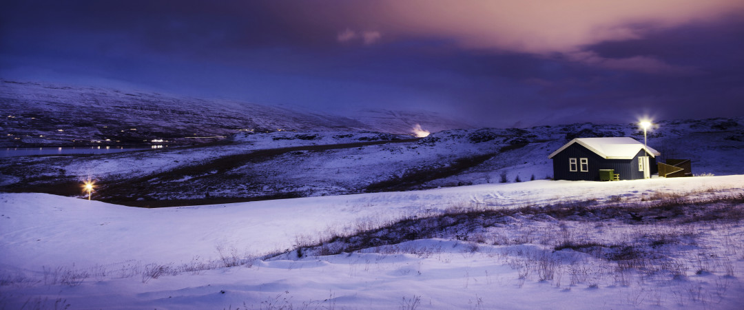 Watch the northern lights in Akureyri's night sky for an unforgettable winter experience.