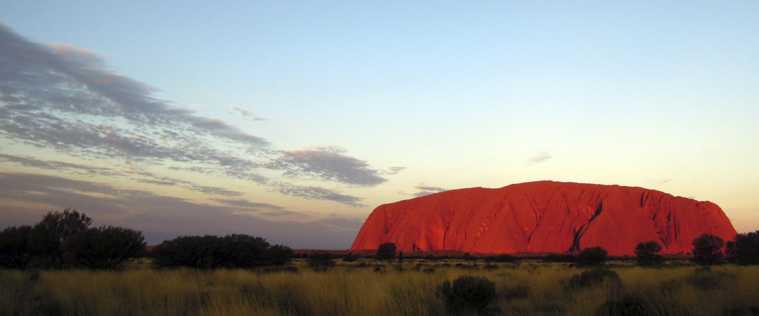 See the iconic Ayers Rock and watch it turn red at dusk.