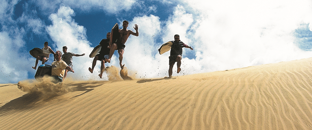 Enjoy sand boarding in Ahipara.