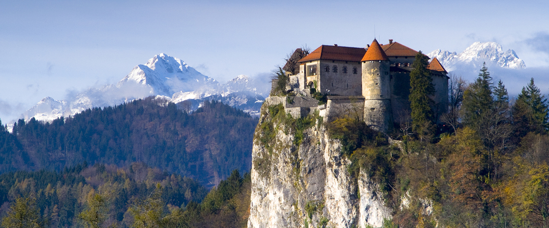 Experience an unforgettable view of the Bled glacier lake from the Bled castle surrounded by the mighty Julian Alps.