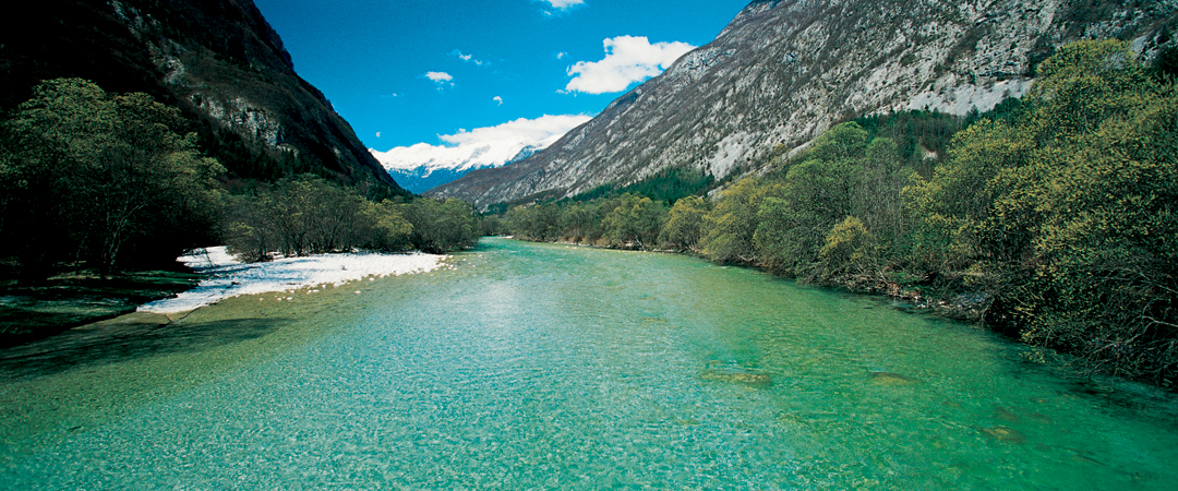 Soča, with its unique turquoise colour, purity, innocence and a spring beneath the mighty Julian Alps invites you into into its embrace.