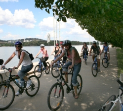 Visitors to Canberra cycling around Lake Burley Griffin