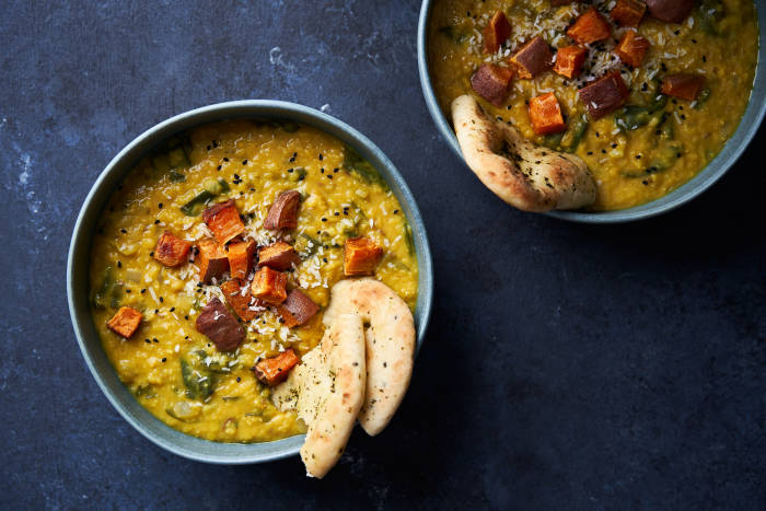 Two bowls of sweet potato topped dhal