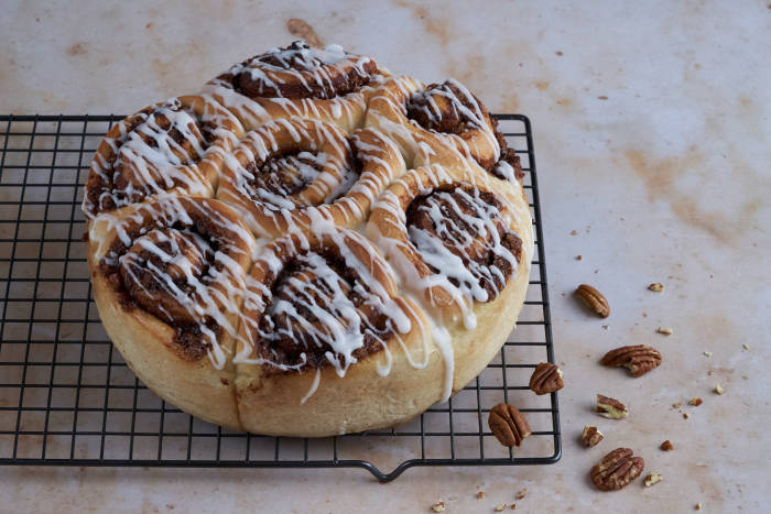 Sweet cinnamon and pecan rolls that use dough from a bread maker