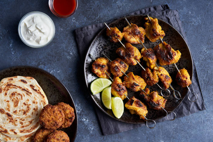 Dishoom's chicken tikka with parathas, bhajis, yoghurt and chilli