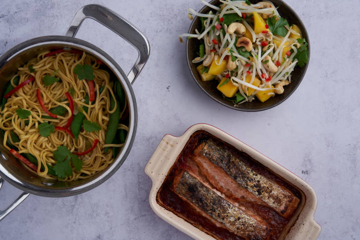 A healthy, spicy salmon dish with an Asian inspired sauce and vegetable noodles in broth.