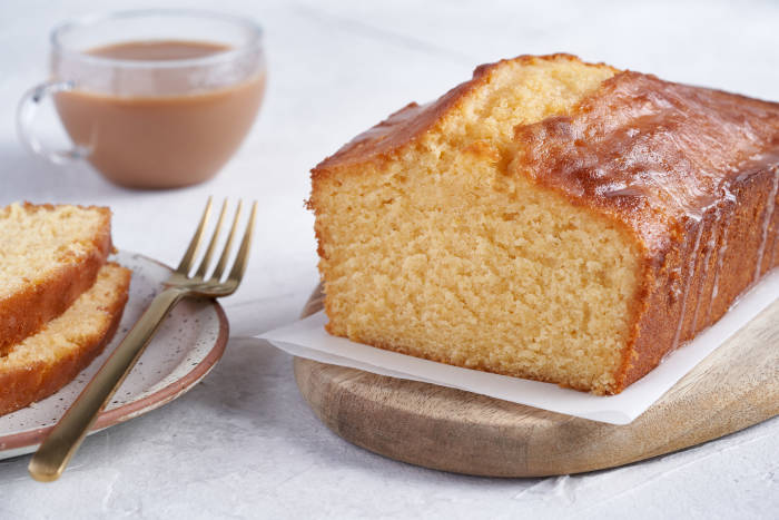 Lemon drizzle loaf cake with a cup of tea