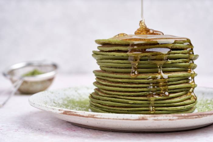 Matcha green tea pancake stack with maple syrup