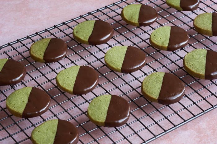 Chocolate dipped Matcha shortbreads on wire rack