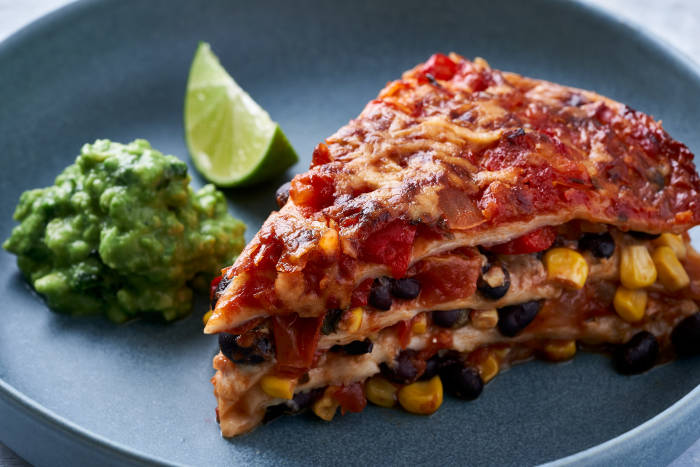 Wedge of Mexican lasagne with guacamole