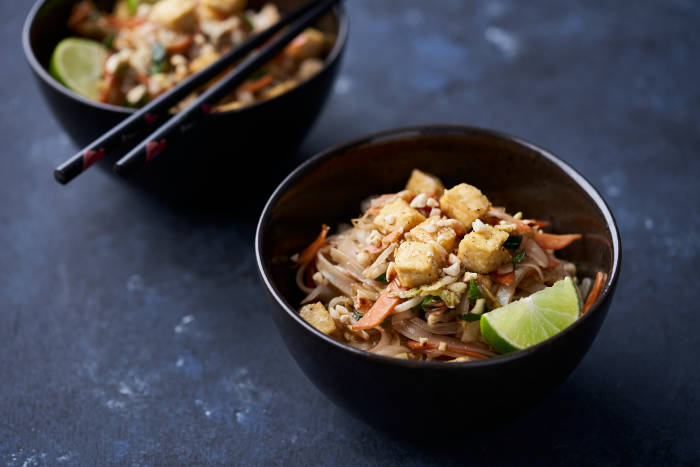 Two bowls of noodles with tofu