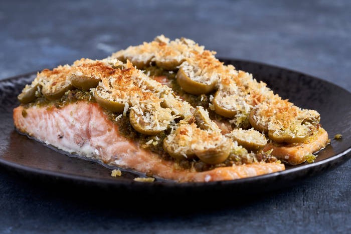 Salmon fillets topped with pesto breadcrumbs and olives
