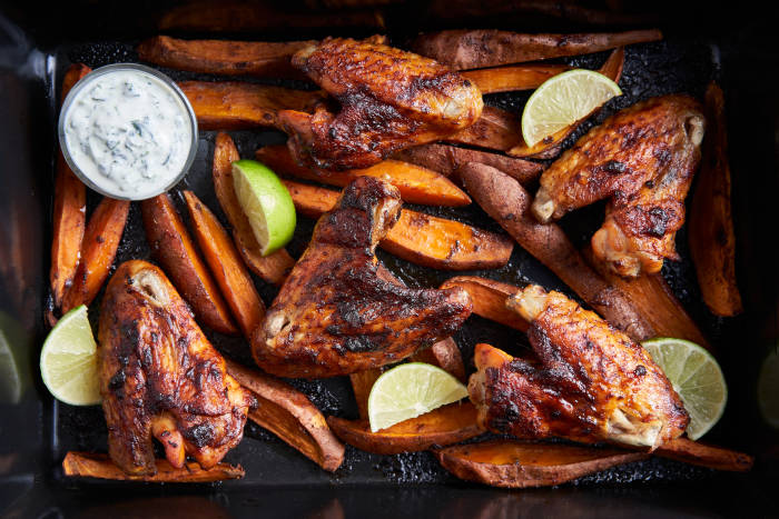 The Roasting Tin: Chipotle chicken wings and sweet potato wedges with coriander and lime yoghurt