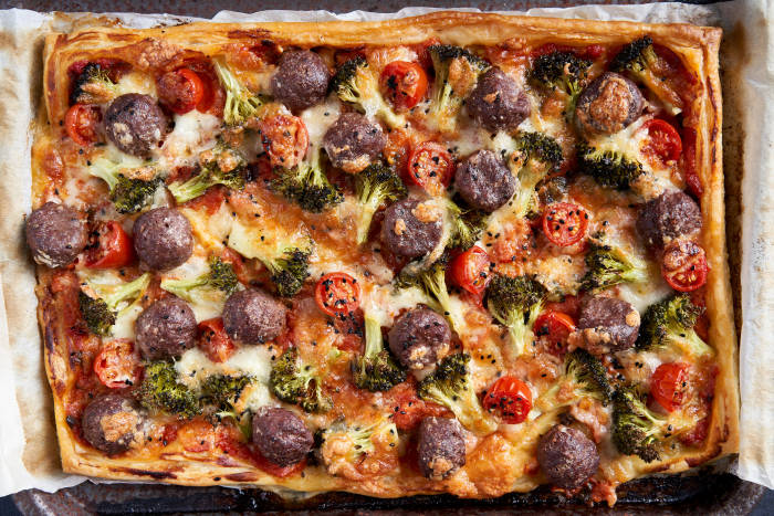 Meatball puff pastry pizza with cherry tomatoes, broccoli and mozzarella